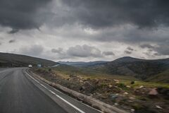 Road Near Brown Stone during Cloudy Stock Photos