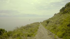 Road near the hill and panoramic view of Baikal lake. Amazing horizontal view stock video