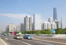 Road near International Finance Center. Road with cars near International Finance Center in day in Guangzhou, China Royalty Free Stock Photos