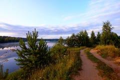 Road near the lake. stock photos