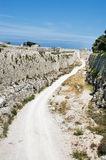 Road near medieval wall, rhodos Stock Photography