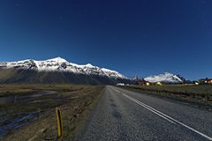 Road near mountain and blue sky background in Hofn, Iceland. royalty free stock photo