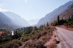 Road near mountains and rivers in Andes, Santiago, Chile Stock Photo