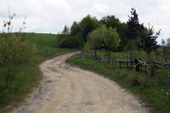 The road near old wooden fence Stock Photo