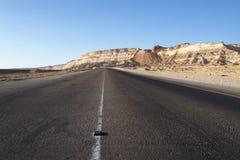 Road near Shuwaymiyah, Oman. Road from a coastal village Shuwaymiyah to inland city Shalim Stock Photos