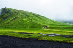 Road near Skogafoss waterfall in Iceland Stock Image
