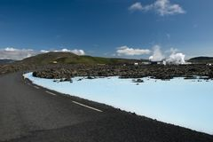 Road near Svartsengi Power Station. That is using geothermal energy to produce electricity in very clean way. Geothermal water is lately used in Blue Lagoon Stock Photo
