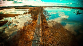 Road near water. Spring time at sunset, aerial view Stock Image