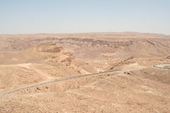 road in Negev desert. Road running through the barren Negev Royalty Free Stock Image