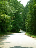 Road through the neighborhood. A hilly trail road through a neighborhood Stock Image