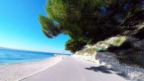Road next to coast - Croatia stock video
