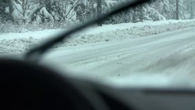 The road next to the forest with a lot of slush stock footage