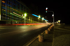 A road at night. In Tel Aviv with colorful light trails from passing traffic Royalty Free Stock Photo