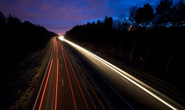 Road at Night. Showing blurred headlights Stock Photo