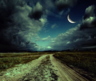 Road in the night. Country road leading to the church Royalty Free Stock Images