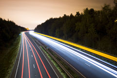 Road at Night. Showing blurred headlights Stock Image