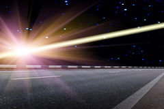 Road  night  asphalted   covering. Shined with bright light of a falling star Royalty Free Stock Images