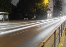 Road at night with light trails of cars Royalty Free Stock Photo