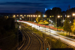 Road at Night by Rails Stock Photo