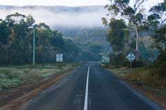 Road with No overtaking road sign. Road with No Overtaking on Bridge road sign. Rural infrastructure landscape royalty free stock photo