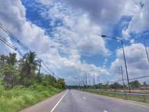 On The road from Nongkhai to Khonkaen, Thailand. Beautiful blue sky and green scenery along the side of the road from Nongkhai, Udon and Khonkaen, Thailand Royalty Free Stock Photos