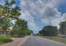 On The road from Nongkhai to Khonkaen, Thailand. Beautiful blue sky and green scenery along the side of the road from Nongkhai, Udon and Khonkaen, Thailand Royalty Free Stock Images