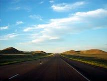 On the Road in North Dakota. A North Dakota landscape at sunset Royalty Free Stock Image
