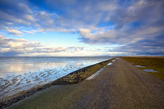 Road by North Sea in Netherlands Stock Image