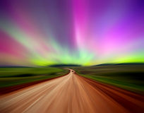Road with Northern lights royalty free stock photos