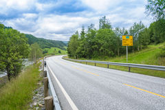 Road in Norway along the forest and river Stock Photo