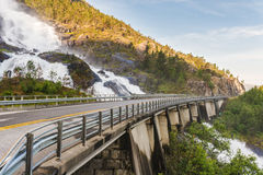 Road in Norway passing over the waterfall Langfoss Royalty Free Stock Images