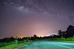 An old road with a milky way view at night. The road not taken. An old road with a milky way view at night royalty free stock image
