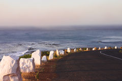 The road by the ocean. Winding road, running through the mountain by the ocean, South Africa Stock Image