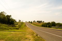Road over the hill. Road in Oklahoma this is a filming location for the movie Twister Royalty Free Stock Photography