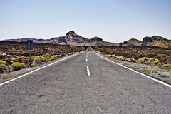 Road through old lava field in Teide National Park. Road through old volcanic lava field in south-western part Teide National Park, El Sombrerito is in Royalty Free Stock Photos