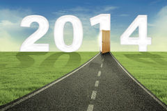 The road and open door to new future. New future concept with the road and open door to new future in 2014 Stock Image