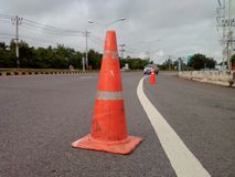 Orange cones. On the road white long line, and car Stock Images