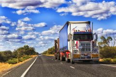 Road Outback Rd Train. Long mighty road train truck moving cargo across Australia on a remote lonely empty outback highway in rural NSW royalty free stock photography