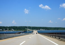 Road over a bridge. With ocean and forest view Stock Image