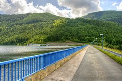 Road over dam of hydroelectric power station Stock Image