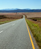 Road over farm lands Stock Photos