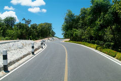 Road over a hill. Winding country-road over a hill royalty free stock photo