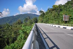 Road over a hill Stock Photo