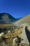 Road over Himalayan Mountains. With barrier and rocks Royalty Free Stock Photos
