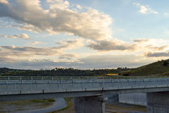 Road over the Jindabyne Dam wall with mountain background Royalty Free Stock Image