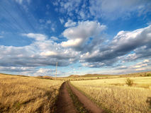 Road over yellow hills. Unmetalled road in south Ural mountains. Russia stock images