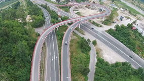Road overpass connecting urban areas, aerial overflight stock video