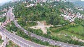 Road overpass near urban area, aerial presentation stock video footage