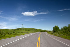 Road With Painted Double Yellow Line. Photo was taken in Alberta, Canada Royalty Free Stock Photography