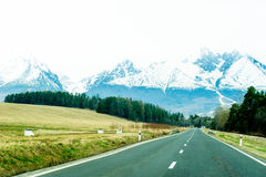 Road with panorama of High Tatra mountains Royalty Free Stock Photography